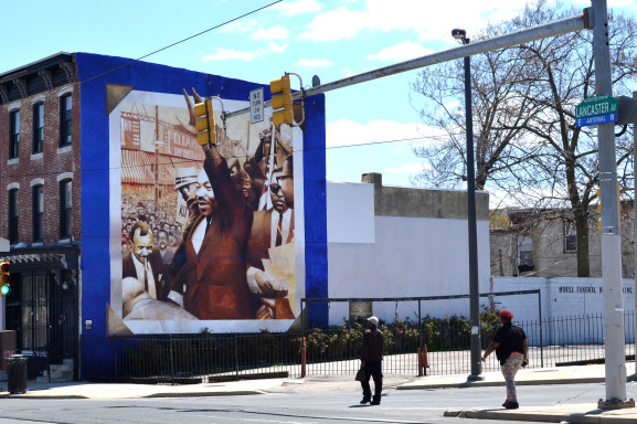 A mural is painted on the corner of 40th and Lancaster Avenue to commemorate the 1965 rally held by Martin Luther King.