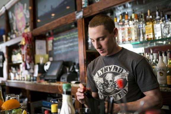 Bartender Brian Padgett of Tap Room on 19th mixes a specialty cocktail.