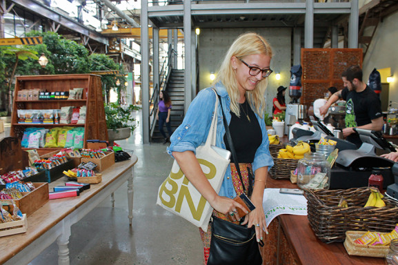 Rachel Dwyer, a recent University of the Arts graduate and current photography intern at Urban Outfitters, enjoys the creative space of the company's headquarters.