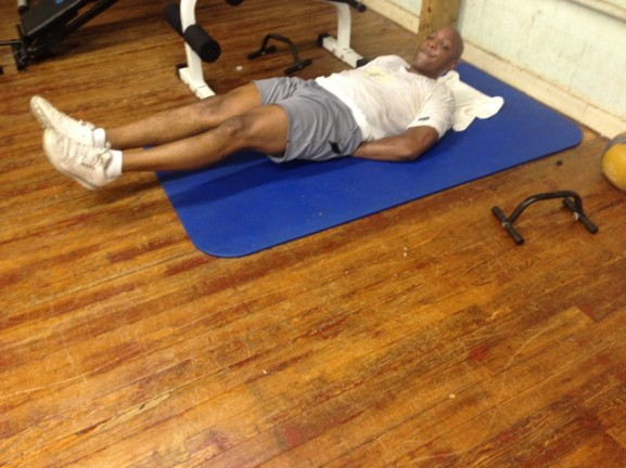 Tyrone Glover gets ready to begin a set of sit-ups.
