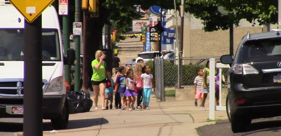 Children enter a daycare center, one of two child care facilities located on the same block as the methadone clinic.