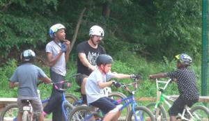 Ray Lowder talks with kids at Philly Pumptrack while waiting to use advanced track.