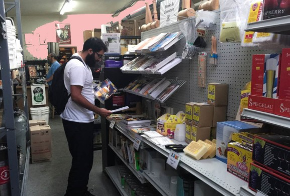A customer browsing books about beer at the Philly Homebrew Outlet.