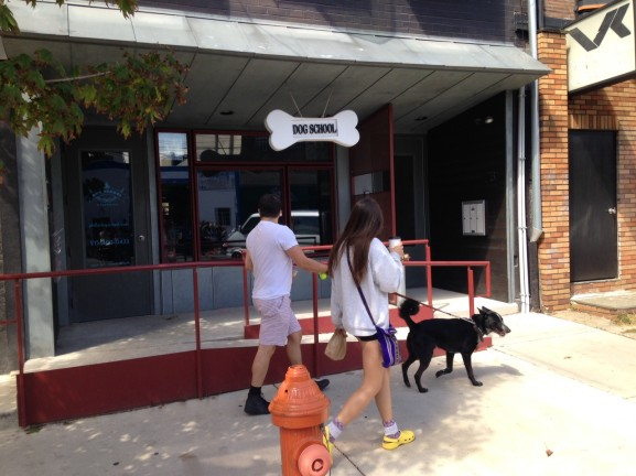 Residents of Northern Liberties walking into Dog School to benefit from all the services they provide.
