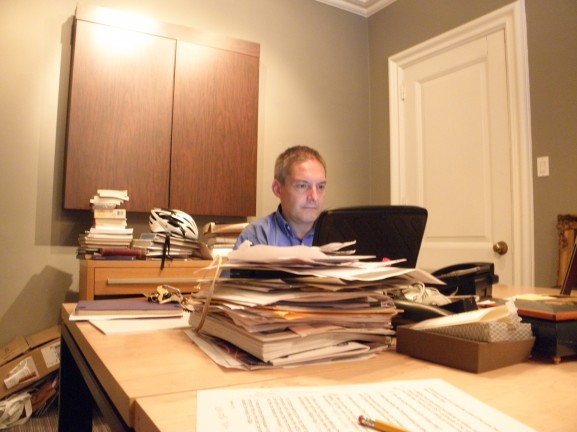 Chris Bartlett works at his desk at William Way Community Center