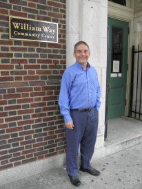 Chris Bartlett poses outside of William Way Community Center