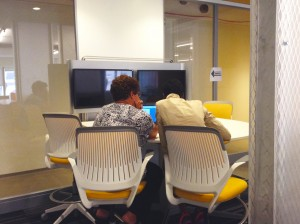 PHMC employees work in a new meeting room.