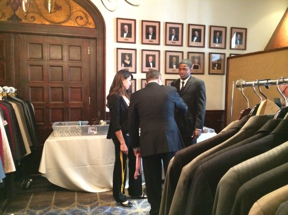 "Veterans get fitted for a donated suit through the ""suiting warriors"" program."