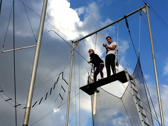 Instructor Rachel Rovlin (left) hooks onto the trapeze bar as David Struewing (right) prepares to swing.