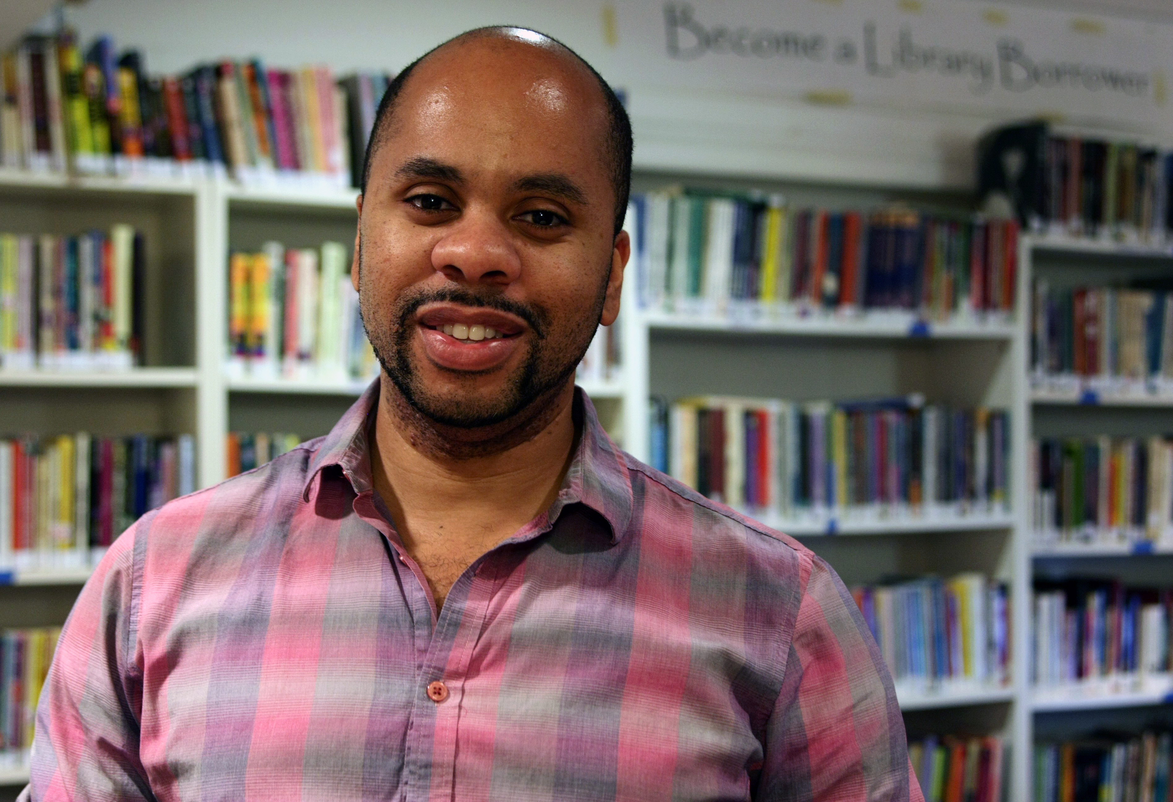Eric Thomas, program director at the William Way LGBT Community Center, sits down in the center's library to talk about the papal visit in Philadelphia. The center will be holding a multitude of activities for the LGBT community during this time to avoid the members feeling alienated.