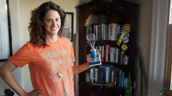 Danielle Redden showed off her twelfth place trophy at last year's Mummers parade.