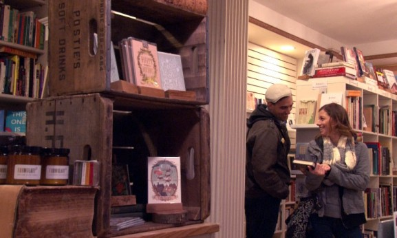 Customers in The Spiral Bookcase bond over books.