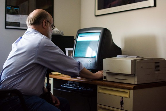 Executive Director Jerry Bolzak on his computer in the Northeast Victim Service Mayfair office on Friday, Jan. 29, 2016.