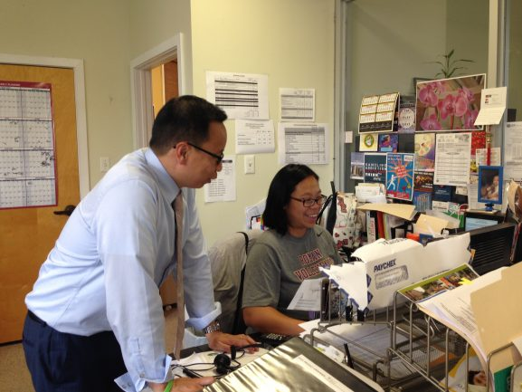 Chin checks on, and exchanges banter with, Ping-Ho Lee, PCDC programs manager.