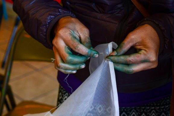 The hands of Hlawm Sung are stained green after she participated in a textile and scarf dying workshop taught by local artist Nancy Volpe Beringer.