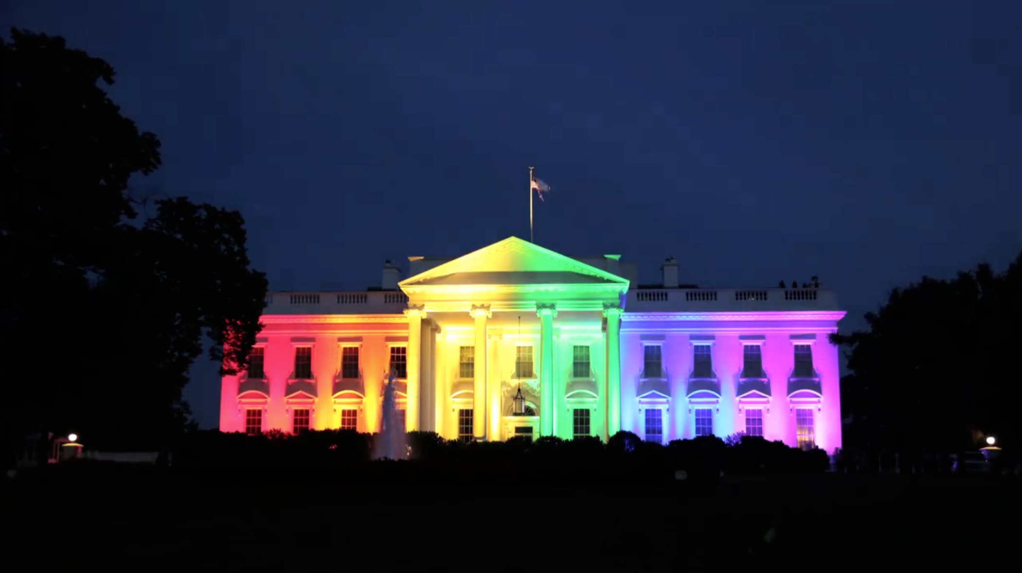 Timelapse white house beams in rainbow color lights the for The white housse