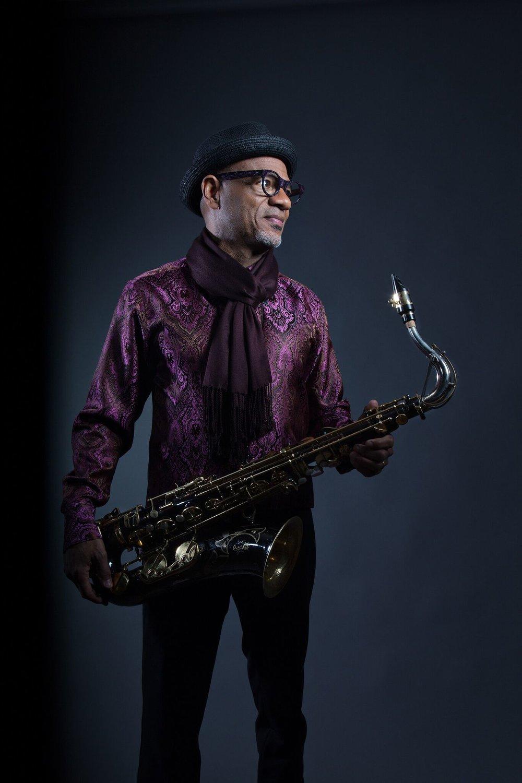 Kirk Whalum holding saxophone