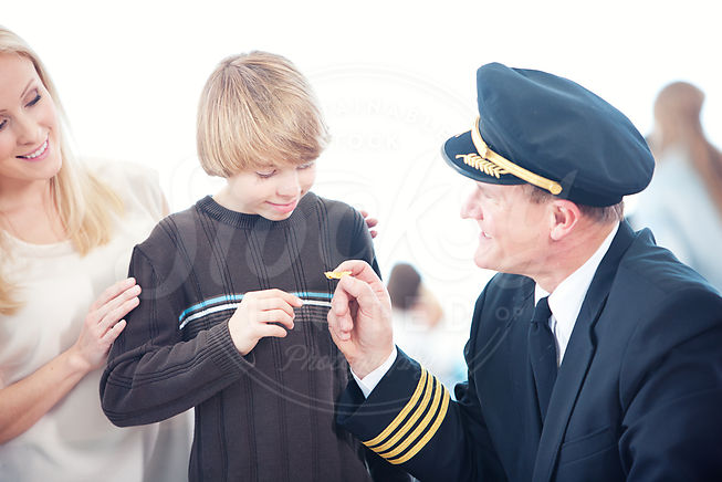 boy gets pin from captain