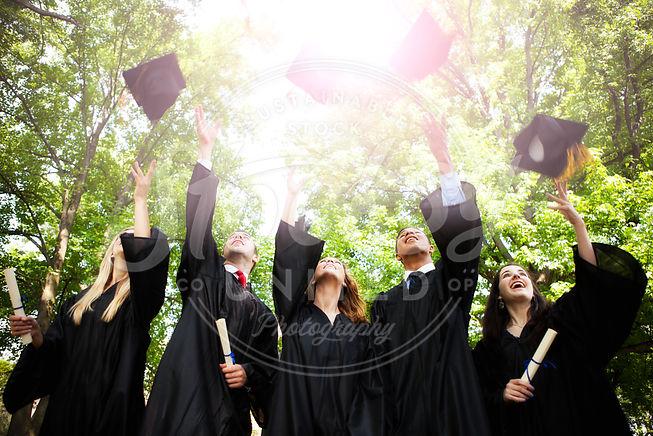 Group of Graduates with Diplomas