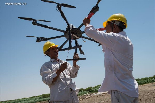 Feature: China-built power grid shines hearts of grass roots in Egypt