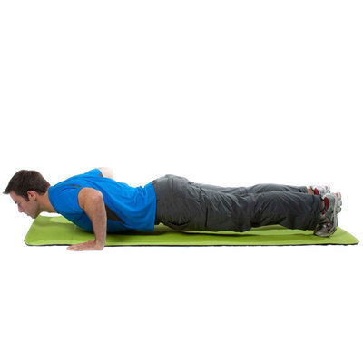 Lower your torso to the ground until your elbows form a 90 degree angle.