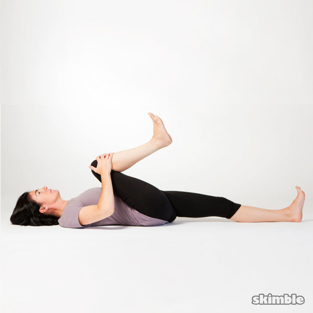Floor Knee To Chest Stretch Exercise How To Workout