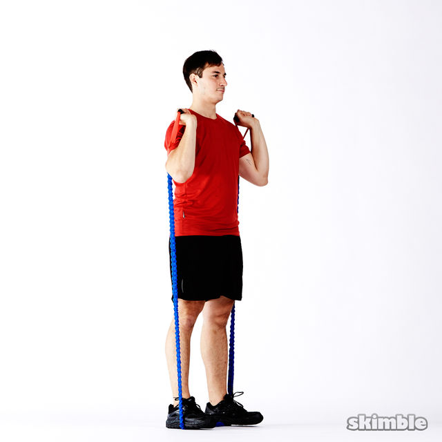 How to do: Band Squats with Press - Step 1