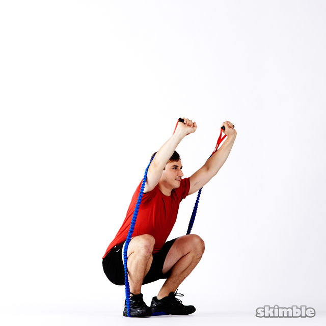 How to do: Band Squats with Press - Step 2