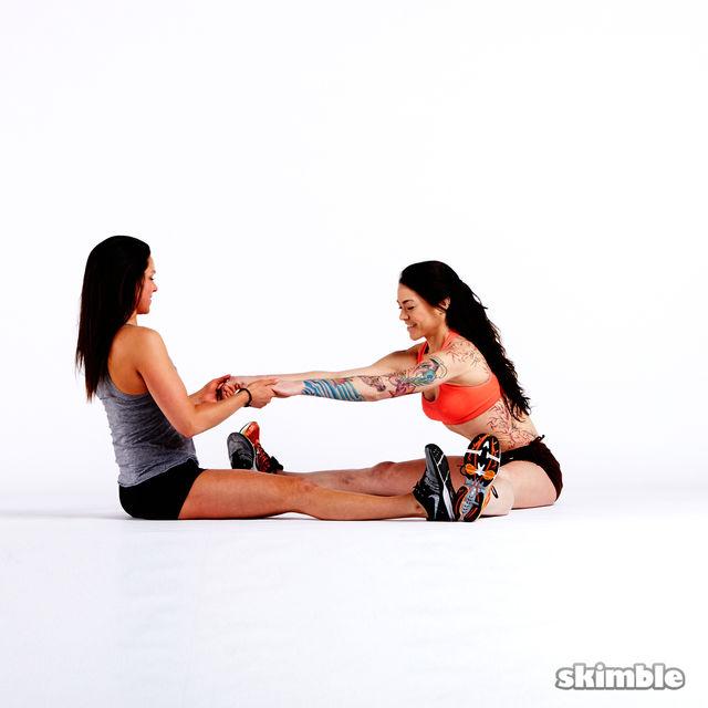 How to do: Buddy Split Stretches - Step 2