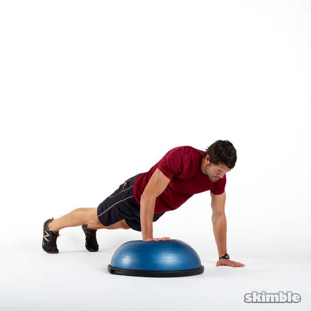 How to do: BOSU Right Offset Push-Ups - Step 1
