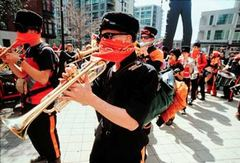 Caption: The Infernal Noise Brigade in downtown Seattle., Credit: http://www.andrewstern.net/