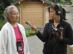 Caption: Mara Kumagai Fink (right) interviewing her great aunt Matsue at Manzanar, the camp she was brought to in northern California.