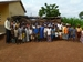 Caption: Head teacher Adams Abdulai Iddrisu (left) stands with students at Zoozugu Primary School in the Tamale region of northern Ghana, outside a children's creche area built by the community., Credit:  UNICEF Ghana/2010/Williams
