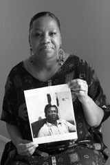 Caption: Bridgette McGee holds a photo of her grandfather, Credit: Teri Havens