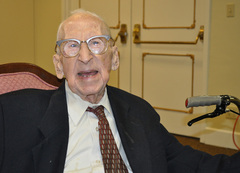 Caption: Walter Breuning just days before his 114th birthday, Credit: Emilie Ritter