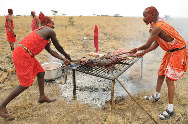 Image result for Maasai morans eating meat