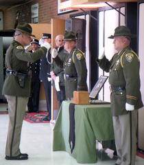 Caption: Trooper DeLaittre's remains guarded outside the funeral service , Credit: Emilie Ritter