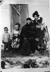 Caption: Kate Frost &amp; family on the Porch, Chippewa City (Jim Wipson lower right), Credit: Courtesy of Jim Wipson 