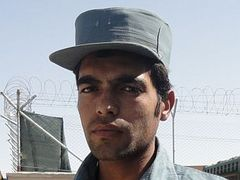 Caption: An Afghanistan National Police trainee., Credit: Steve Zind