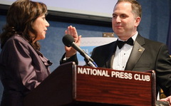 Caption: Mark Hamrick, 104th Press Club President sworn in by US Labor Secretary Solis
