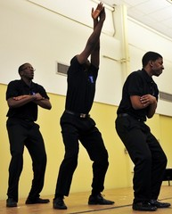Caption: The newly formed Pi Eta chapter of Phi Beta Sigma step before the beginning of the 34th Annual Soul Food Dinner on Saturday in Kryzsko Commons on Winona State University campus. Performing are Sam Ndely, left, Beh Gay, center, and Forrest Agnew. , Credit: David Ranzenberger/Winona Daily News