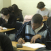 Caption: Students take a standardized test at a high school in Greensboro, North Carolina., Credit: Billy Barnes
