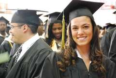 Caption: Students on their graduation day from Montgomery College, a community college in Maryland. Most young Latinos looking for a way up through higher education choose community college, but a lot of them never make it to graduation day. , Credit: Emily Hanford