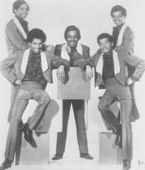 Caption: The Stairsteps circa 1969 (Clockwise: Clarence Burke, Sr. (center), Kenneth M. Burke, James Burke III, Clarence Burke Jr., Dennis Burke.