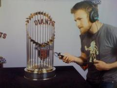 Caption: Producer Max Jacobs with the World Series trophy