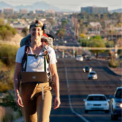 Caption: Camera on head, Laura Milkins walks across Tucson, AZ, Credit: Tom Willette