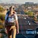 Caption: Camera on head, Laura Milkins walks across Tucson, AZ, Credit: Tom Willette