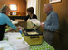 Caption: Rebecca Barrett and the Klines serving lunch, Credit: Philip Graitcer