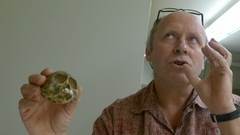 Caption: Bill Stanley and the skull of a new genus he helped identify.
