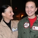 Caption: Rear Adm. Wendi Carpenter congratulates Lt. j.g. Carolyn Bloomfield for earning her carrier qualifications during the Women in Aviation Conference.
